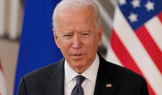 President Joe Biden addresses reporters Tuesday after arriving in Brussels for a summit with European Union leaders.