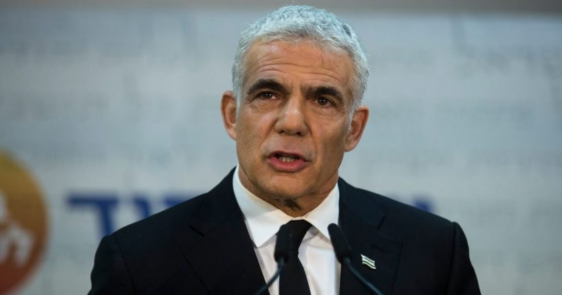 Yair Lapid, Israel's new foreign minister, talks to reporters during a May 6 news conference.