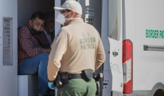 Border Patrol agents process illegal immigrants who turned themselves in in Yuma, Arizona, on May 13.