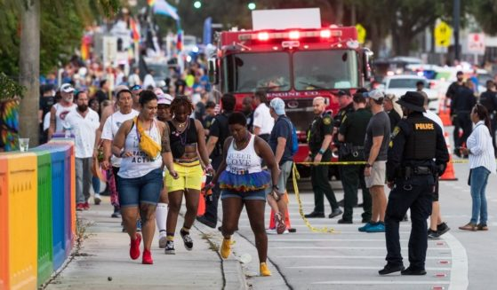 Police investigate the scene where a pickup truck drove into a crowd at a gay pride parade Sunday in Wilton Manors, Florida.