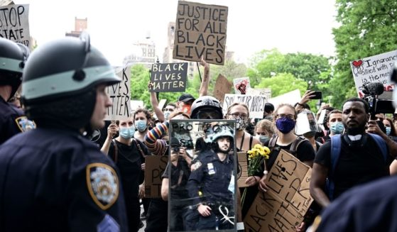 New York City police square off with demonstrators in June 2020 in Manhattan's Washington Square Park.