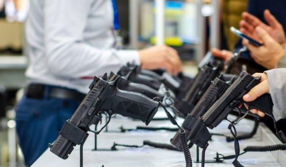 Handguns on display at a gun store.