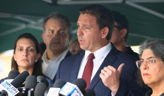 Florida Gov. Ron DeSantis fields questions at a news conference Thursday at the scene of the condominium collapse in Surfside, Florida.
