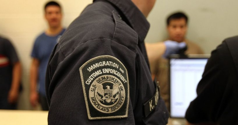 Illegal immigrants are photographed while being in-processed at an Immigration and Customs Enforcement center on April 28, 2010, in Phoenix.