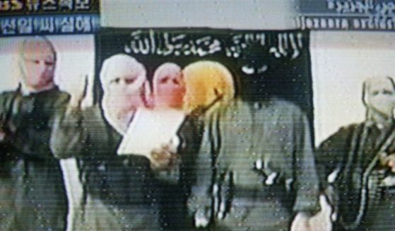 This image broadcast by the Arab news station Al-Jazeera shows an Iraqi militant group on June 22, 2004.