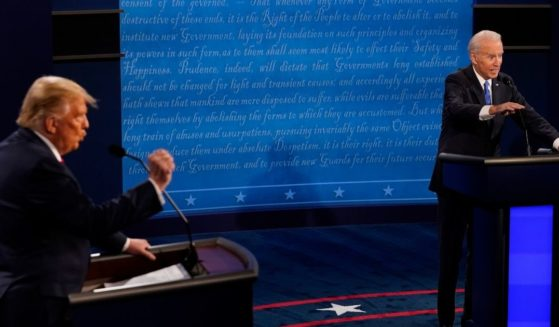 Then-Democratic presidential candidate Joe Biden answers a question as then-President Donald Trump listens during the second and final presidential debate at Belmont University on Oct. 22, 2020, in Nashville, Tennessee.