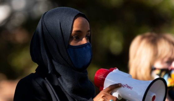 Then-Minnesota Democratic Congressional candidate Ilhan Omar, joined by then-Democratic Senate candidate Tina Smith, speaks during a get out the vote event on the University of Minnesota on Nov. 3, 2020, in Minneapolis, Minnesota.