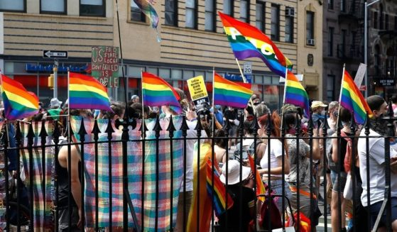 Marchers congregate in front of the Stonewall Inn during the Queer Liberation March for Black Lives & Against Police Brutality on June 28, 2020.