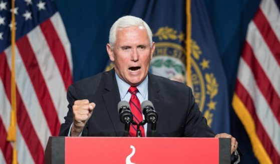 Former Vice President Mike Pence addresses the GOP Lincoln-Reagan Dinner on June 3 in Manchester, New Hampshire.