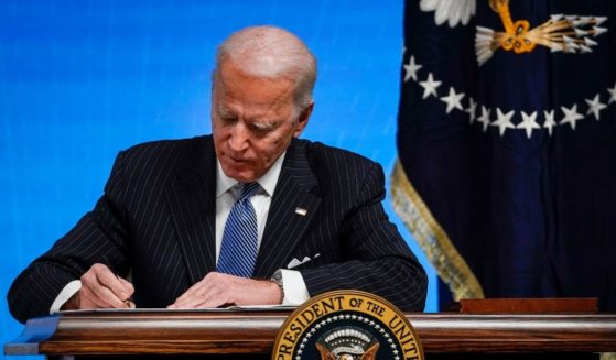 President Joe Biden signs an executive order related to American manufacturing in the South Court Auditorium of the White House complex on Jan. 25, in Washington, D.C.