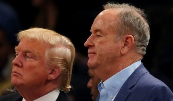 Donald Trump and Bill O'Reilly attend a game between the New York Knicks and the Cleveland Cavaliers at Madison Square Garden in New York City on Nov. 30, 2014.