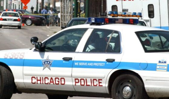Chicago Police activity is seen near Windy City Core Supply Inc., an auto parts warehouse in which seven people, one of them being the gunman, were killed August 27, 2003 in Chicago.