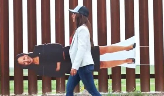 Colorado Republican Rep. Lauren Boebert carries a cutout of Vice President Kamala Harris along the U.S.-Mexican border in a Twitter video released on June 8.