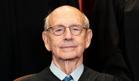 Associate Justice Stephen Breyer sits during a group photo of the Supreme Court justices at the Supreme Court in Washington, D.C., on April 23, 2021