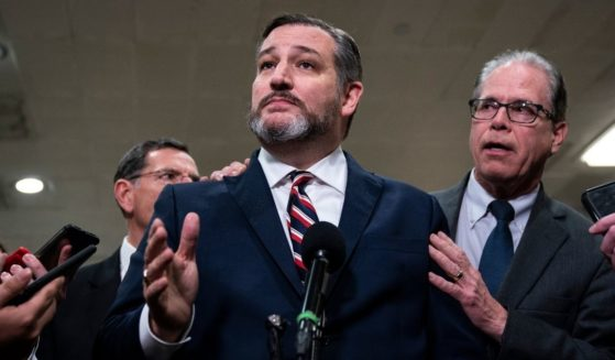 Republic Sens. Ted Cruz of Texas and Mike Braun of Indiana speak to the media during a dinner break in the Senate impeachment trial at the U.S. Capitol Jan. 27, 2020, in Washington, D.C.