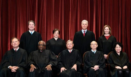 The Supreme Court justices pose during a group photo at the Supreme Court in Washington, D.C., on April 23.