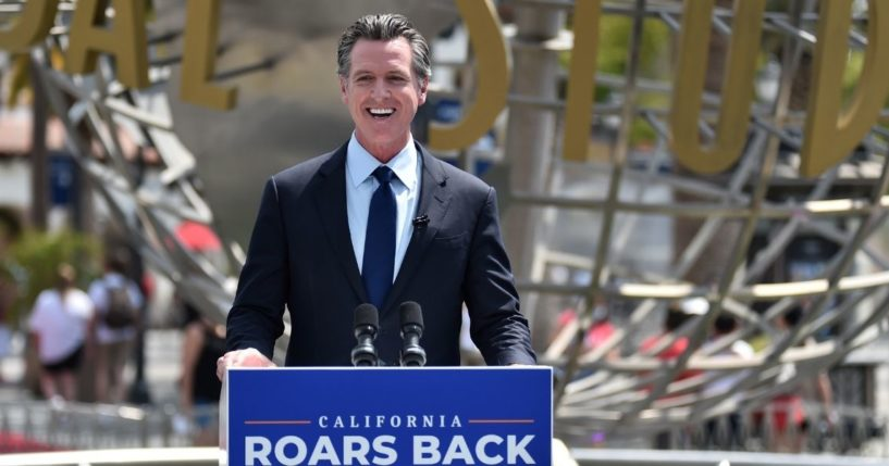 California Gov. Gavin Newsom attends a news conference for the official reopening of the state at Universal Studios Hollywood on June 15, 2021, in Universal City, California.