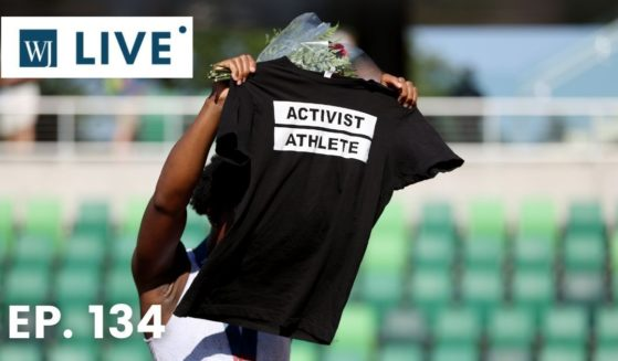 Gwendolyn Berry displays an Activist Athlete shirt as she celebrates finishing third in the Women's Hammer Throw final on day nine of the 2020 U.S. Olympic Track & Field Team Trials at Hayward Field on Sunday in Eugene, Oregon.