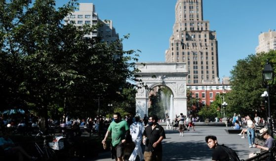 People enjoy a warm afternoon in Manhattan's Washington Square Park on June 10 in New York City.