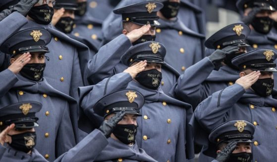 United States Military Academy Corps of Cadets salute during the national anthem before the start of a game between the Army Black Knights and the Navy Midshipmen at Michie Stadium on Dec. 12, 2020, in West Point, New York.