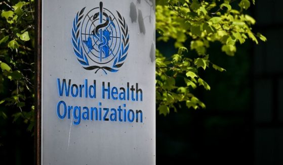 A picture taken on May 8 shows a sign of the World Health Organization at the entrance of its headquarters in Geneva.