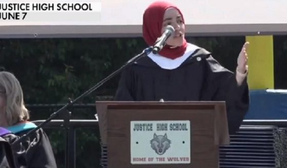 Fairfax County, Virginia, school board member Abrar Omeish delivers the commencement address June 7 at Justice High School in Fairfax, Virginia.