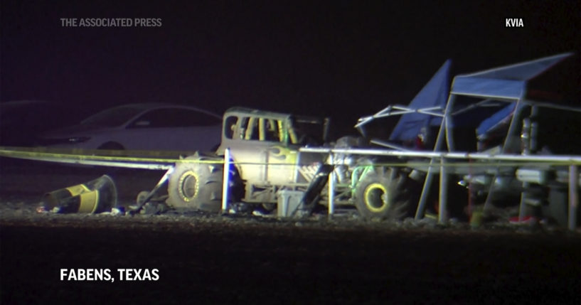 An image from a video shows cars and tents after a vehicle plowed into a crowd at a mud racing event in Fabens, Texas, on Sunday.