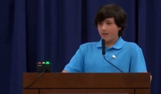 Minnesota teenager Brad Taylor speaks before his soon-to-be-former school board.