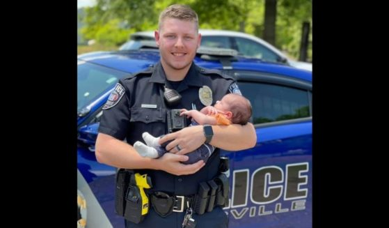 Officer Cody Hubbard and baby Grady, whose life the rookie officer saved in late May.
