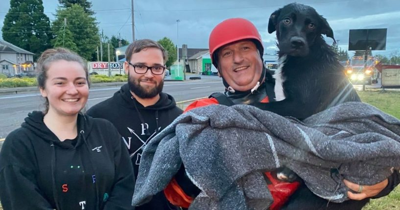 The two good Samaritans and the firefighter who performed the rescue for a dog stranded in a canal in Lebanon, Oregon.