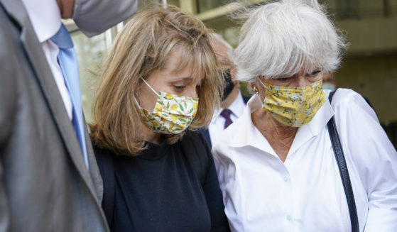 Allison Mack, center, leaves federal court with her mother, Mindy Mack, after being sentenced on Wednesday in New York.