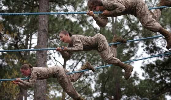 Female Marine recruits navigate an obstacle course during boot camp on Feb. 27, 2013, in Parris Island, South Carolina.