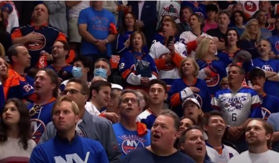"""Hockey fans gave a stirring rendition of """"The Star-Spangled Banner"""" on Wednesday, taking over for the national anthem singer before a playoff game between the New York Islanders and the Boston Bruins."""