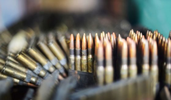 Lines of ammunition prepared to be loaded into magazines.