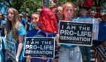 Pro-life protesters stand outside the Texas Capitol on May 29, 2021, in Austin, Texas.