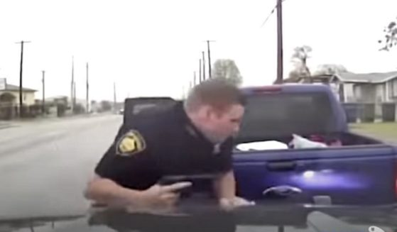 Officer Tyler Sauvage engages with a gunman during an April 16 traffic stop.