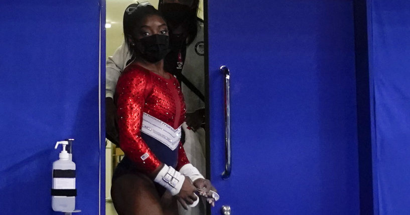 Simone Biles leaves a medical station during the artistic gymnastics women's final at the 2020 Summer Olympics in Tokyo on Tuesday.
