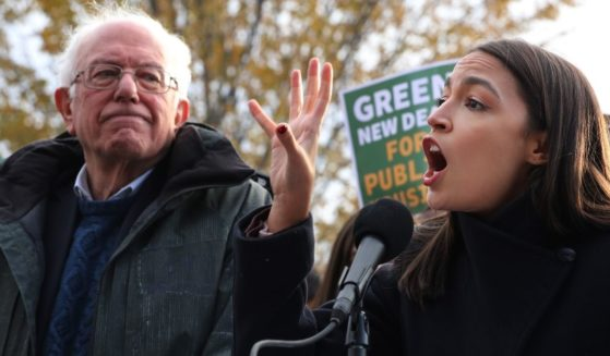 Leftist Sen. Bernie Sanders of Vermont and Democratic Rep. Alexandria Ocasio-Cortez of New York hold a news conference to introduce legislation to transform public housing as part of their Green New Deal proposal outside the U.S. Capitol in Washington on Nov. 14, 2019.
