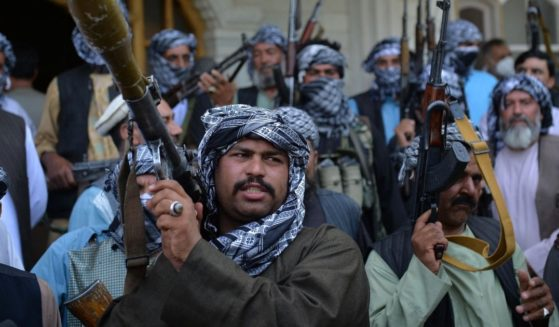 Afghan militia gather with their weapons to support Afghanistan security forces against the Taliban in Afghan warlord and former Mujahideen leader Ismail Khan's house in Herat on Friday.