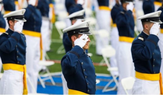 Members of the United States Air Force Academy class of 2021 salute during their graduation ceremony at Falcon Stadium on May 26, 2021, in Colorado Springs, Colorado.