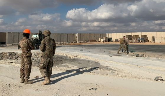 U.S. troops clear rubble at Ain al-Asad airbase in the western Iraqi province of Anbar on Jan. 13, 2020.