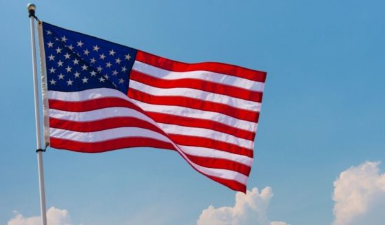 An American flag is pictured in Jersey City, New Jersey, in the stock image above.