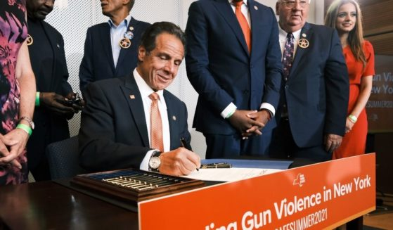 New York Gov. Andrew Cuomo signs a bill and declares a state of emergency due to gun violence on Tuesday in New York City.