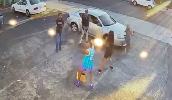 Released surveillance video shows an attempted robbery that failed after the robbers' target drew a gun and fired.