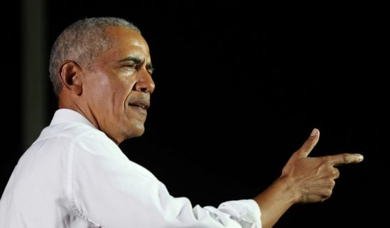 Former President Barack Obama speaks in support of then-Democratic presidential nominee Joe Biden during a drive-in rally at the Florida International University on Nov. 2, 2020, in Miami.