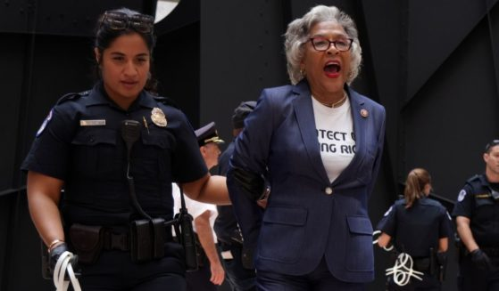 Democratic Rep. Joyce Beatty of Ohio is led away by a U.S. Capitol Police officer during a demonstration at the Hart Senate Office Building on Capitol Hill in Washington on Thursday.