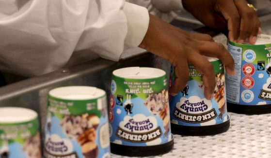 A laborer works on a production line filling ice cream pots at the Ben & Jerry's factory in Be'er Tuvia in southern Israel on Wednesday.