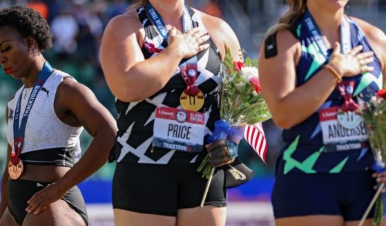 Gwen Berry, who finished in third place, turns away from American flag during the national anthem after the women's hammer throw final at the U.S. Olympic Track & Field Team Trials at Hayward Field in Eugene, Oregon, on June 26.