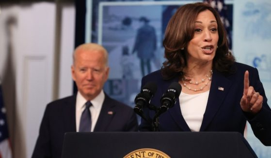 Vice President Kamala Harris, right, and President Joe Biden deliver remarks in the South Court Auditorium in the Eisenhower Executive Office Building on July 15, 2021, in Washington, D.C.