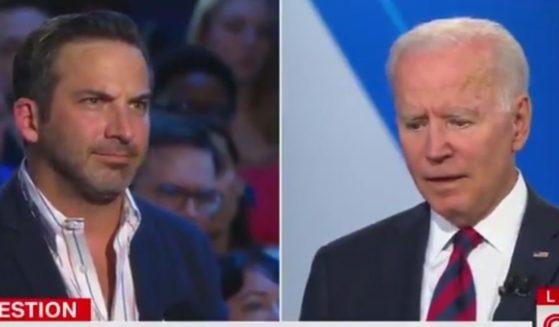 Restaurant owner John Lanni, left, asks a question of President Joe Biden at a CNN town hall hosted at Mount St. Joseph University in Cincinnati on Wednesday.